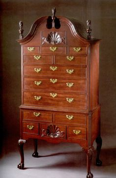 A Fine and Rare Chippendale Carved and Figured Mahogany High Chest, Philadelphia, Pennsylvania, possibly by Jonathan Claypool, circa 1760, appears to retain its original hardware, height 92 1/4in. by width 44 1/4in. by depth 23 1/2in. This handsome high chest displays distinctive stylistic details associated with the work of the Claypoole family, an important multigenerational cabinet shop spanning three generations, which operated in Philadelphia for most ot the eighteenth century.