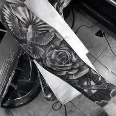 Badass Sleeve Tattoo With Cross Rose Flower And Flying Dove For Men