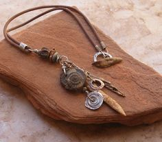 Dawn Wilson-Enoch/deserttalismans - Primitive Fossil, Sterling and Bronze Amulet, Handmade Beads on Leather Cord
