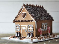 Chocolate Chambers : Finally, a gingerbread house you'll actually want to eat. From the shutters to the shingles, this chocolate-covered house was designed with flavor in mind. Learn how to make it with this step-by-step guide from Food Network Kitchen.  Photography by Armando Moutela