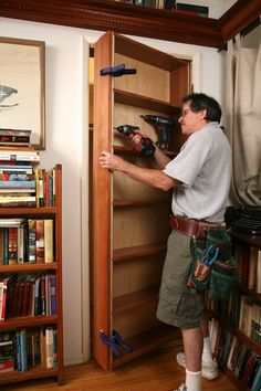 """A design-and-build technique article about """"hidden pivot bookcase/door"""" installations -- article makes clear this is no simple project!"""