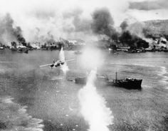 November 2, 1943: A B-25 bomber of the U.S. Army 5th Air Force strikes against a Japanese ship in the harbor at Rabaul, New Britain during an air raid on the Japanese-held air and naval base. (AP Photo)