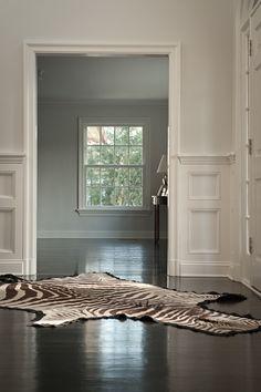 Dark wood floor and zebra rug