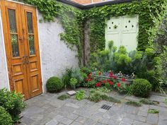 Beautiful courtyard.  I have a bath, and a concrete wall to cover up, along with a garden shed to construct. Perfect solution!