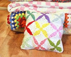 A while back I fell in love with a piece of wall art I found at modobject at home, so until I get my husband to make one for me…I satisfied my lust with a new crochet square pattern and made myself the a pillow.  Tara Murray © May 2011 Materials: *I hook *Worsted...