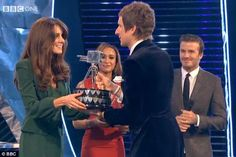 Popular choice: Bradley Wiggins receives the BBC Sports Personality of the Year award from the Duchess of Cambridge