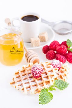 Fresh Belgian waffles with raspberries, honey and cup of coffee on a white background Belgian Waffles, Raspberries, Coffee Cups, Honey, Fresh, Cooking, Breakfast, Food, Belgium Waffles