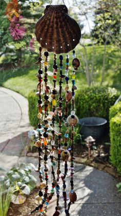 My second wind chimes project, this time with shells and assorted glass and wooden beads.
