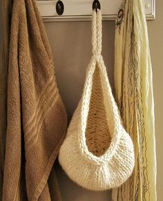 Free Knitting Pattern for Hanging Basket - This hanging basket is great for small towels or toiletries in the bathroom or mittens and hats in the closet. Only took one skein of super bulky yarn according to the designer Ashley Collings.
