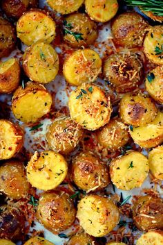These Oven Roasted Herb and Garlic Parmesan Potatoes are the perfect side dish to whatever you're making for dinner tonight! Perfectly crispy on the outside and light and fluffy on the inside. /momontimeout/