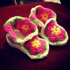 Ravelry: African Flower Baby Booties pattern by Marjolein Loomans......free ravelry download....says fits 6 - 12 months