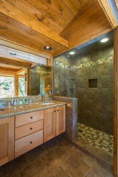 Build in short tile wall as shown; span distance between short tile wall with salvaged shower door.