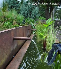 Steel backplate with pipes spilling into a concrete trough. Rocking a gravel garden in the Kuzma Garden: Portland Garden Bloggers Fling   Digging