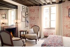 This wonderful townhouse in the Marais is just around the corner from the lovely Place des Vosges.  It has four suite/apartments, accommodating up to ten persons.