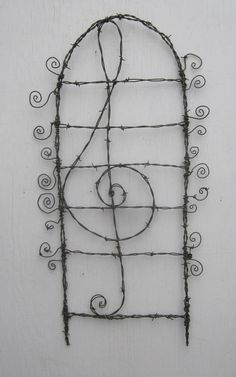 Lovely Lyrical Treble Cleft Barbed Wire  Garden Trellis, thedustyraven, etsy.com