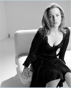 Gillian Anderson striking black and white portrait in a sheer silk satin dress with a low scooped ruffled lace seethrough transparent neckline over a matching black bra / lingerie, star of The X-Files, Hannibal, and American Gods, a modern classic beauty. Gillian Anderson, Dana Scully, X Files, Manequin, Actrices Hollywood, Female Stars, Black White Photos, Famous Women, Famous People