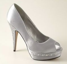 I've decided my bridesmaids will wear silver shoes...lavender dresses, silver shoes, holding orchids :)