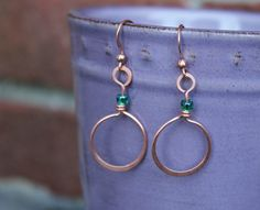 Boho style, rustic, unique design, handcrafted, medium length, hanging earrings, made with forged copper wire and glass seed beads. by SusansLifeOnAWire on Etsy