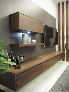 Suspended low TV cabinet with a single wall shelf by Meridien Inspiration