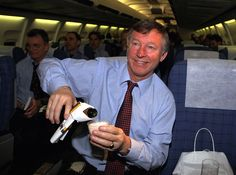 Sir Alex Ferguson pours himself some bubbles after securing @manutd's place in the 1999 Champions League final.