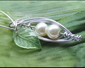 Personalized Peas In A Pod Necklace. Comes with 1 initial/name tag and leaf of your choice