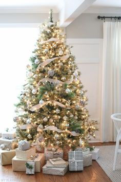 Love this gorgeous Christmas tree complete with gold, silver, and neutral ribbon. And check out the pretty packages underneath with buffalo check paper!