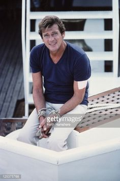 Roger Moore as 007 on the set of 'For Your Eyes Only', February 1981. Here, his hands are tied in readiness for a scene in which he is dragged through shark-infested waters.
