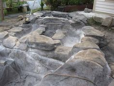 The rocks were then made with latex and mixed colored concrete. He shaped them with a trowel.