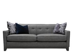 From top to bottom, this Chilson sofa was designed with modern sensibilities in mind. Its streamlined frame with track arms and espresso-finished feet offers up a chic, contemporary vibe. And thanks to elegant details like welted trim and attached back cushions with button tufting, it'll retain its neatly tailored appearance with little effort. Plus, the fashionable look of the charcoal gray upholstery and down accent pillows makes your job as a decorator easy!