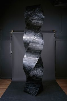 Lorenzo Durantini mixed media artist creates installations of magnetized plastic film. 1   Epic Sculptures Made From Old VHS Tapes   Co.Design: business + innovation + design