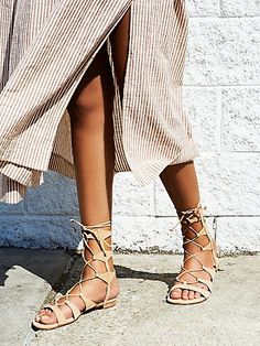 Lina Lace Up Gladiator Sandals | Brazilian leather lace-up gladiator sandals with elegant gold capped heels and leather soles.   *By Schutz