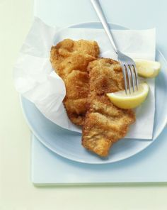 """Wiener Schnitzel means """"Viennese Cutlet"""" in German and is made with breaded veal, chicken or pork cutlets that are fried and served with fresh lemon juice."""