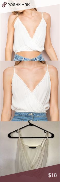 Brandy Melville Jaslyn top White surplice top from brandy Melville. One size but very adjustable! Bought a while ago and still haven't worn it so I figured I'd sell it. NWOT Brandy Melville Tops Tank Tops