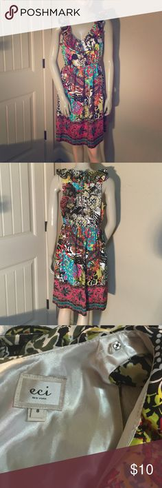 """ECI NEW YORK gorgeous dress size 8 Beautiful! Ties behind neck, keyhole underneath the tie. Built in lining. So comfortable. Excellent condition! Elastic in waistband. Thanks for looking. Measures approx 19"""" underarm to underarm and 37"""" length from shoulder to the bottom. ECI Dresses Midi"""