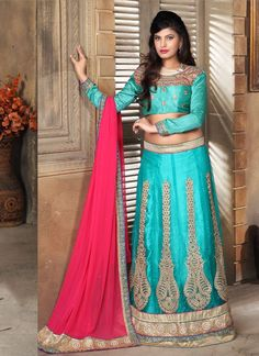 We have ensemble a symphony of enchanting piece to restyle your senses. Fashion and pattern will be at the peak of your elegance as soon as you dresses this turquoise net a line lehenga choli. The att...