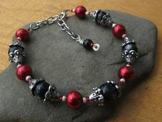 Check out this item in my Etsy shop https://www.etsy.com/listing/245775686/red-black-and-silver-classy-bold