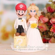 This is from www.fundeliver.com. They specialize in making sugar cake toppers that look like the bride and groom. Very cute and about $350 a pop. Mario and Princess Peach Wedding Cake Toppers