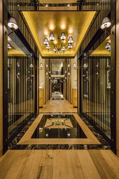 Luxury Queensland Home – Elegant foyer with mirror ceilings. Designer is Mark Gacesa of Ultraspace. Interiors by Minka Joinery www.minkajoinery.com.au