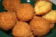 Hushpuppies - Simple fried balls of cornmeal and flour that were actually born out fry coating leftover from the fish fry, though we tend to do them a little more on purpose these days.