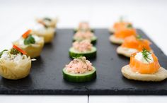 Canapés by Posh Nosh (East Midlands) Smoked Salmon Blini's, Cucumber Cups with smoked trout, Filo Basket's filled with goats cheese, pesto & pine nuts www.poshnosheastmidlands.com