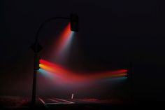 Street Light Art: Traffic Signals Emit Surreal Rainbow Streams in Hazy City