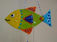 This fish windchime is fun and colorful. It is made of fused glass. The chimes are hung with beads that match glass. They have a soft tinkling sound. The chime is 7 wide and 26 long, including chain. Fused Glass Ornaments, Fused Glass Jewelry, Glass Beads, Stained Glass Patterns Free, Stained Glass Crafts, Glass Artwork, Sea Glass Art, Glass Fusion Ideas, Glass Fusing Projects