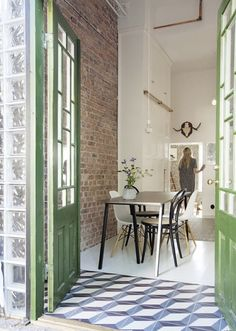 brick + green + decorative tile entryway