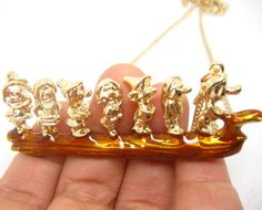 Snow White the Seven Dwarfs on timber necklace by dollarjewelry, $4.50