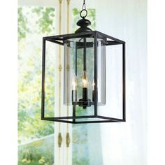 Crafted of an iron frame, this chandelier is accented with clear glass panels making up the shade. An antique bronze finish styles the metal parts of this three-light fixture.