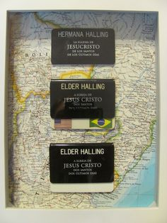 poor quality photo (sorry!), my craft. missionary tags in a shadow box glued to a map of south america. mother's day present.