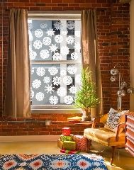 http://www.apartmenttherapy.com/10-times-paper-snowflake-decorations-actually-looked-pretty-fancy-226002