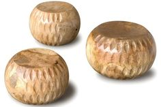 Bola Stool  Each one of these solid carved pieces is simple, yet elegant. They can be used as stools or sculptural accents. They are made of solid wood from recovered urban trees that otherwise would have been burned or turned into mulch.