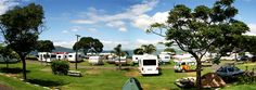 Takapuna Beach Holiday Park – Beachfront Camping and Accommodation, Auckland, NZ. Wake up to a beautiful view of Rangitoto (an inactive volcano) and the Huraki Gulf. Holiday Park, Beach Holiday, Camping New Zealand, Auckland, Volcano, Recreational Vehicles, Dolores Park, City, Travel