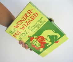 Hey, I found this really awesome Etsy listing at http://www.etsy.com/listing/100713754/book-clutch-purse-the-wizard-of-oz